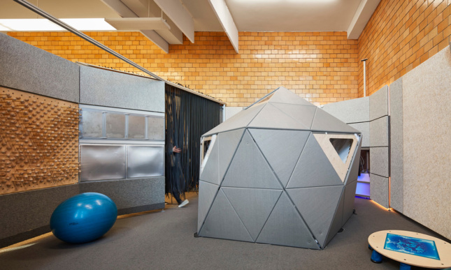 A gray geodesic pod in an interior.