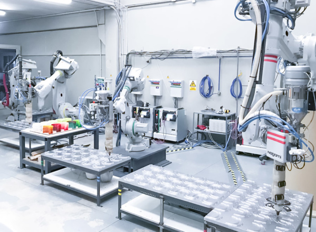 A clean room full of robot arms