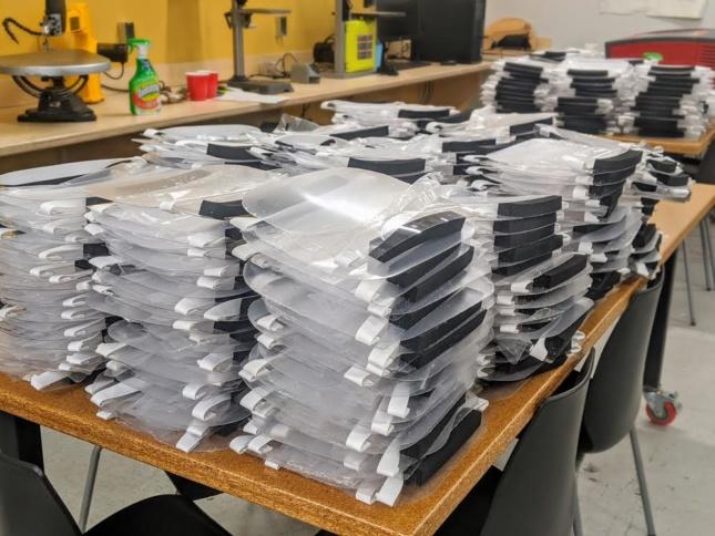 stacks of DIY face shield kits