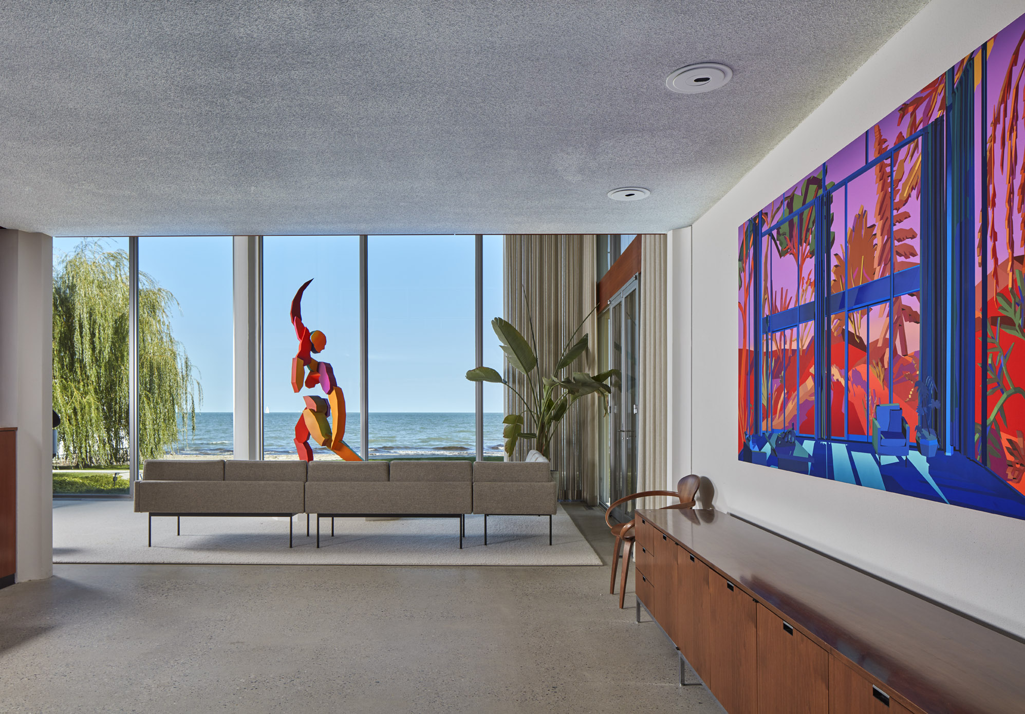 View of a lake from a window with a colorful sculpture in Virtual Window