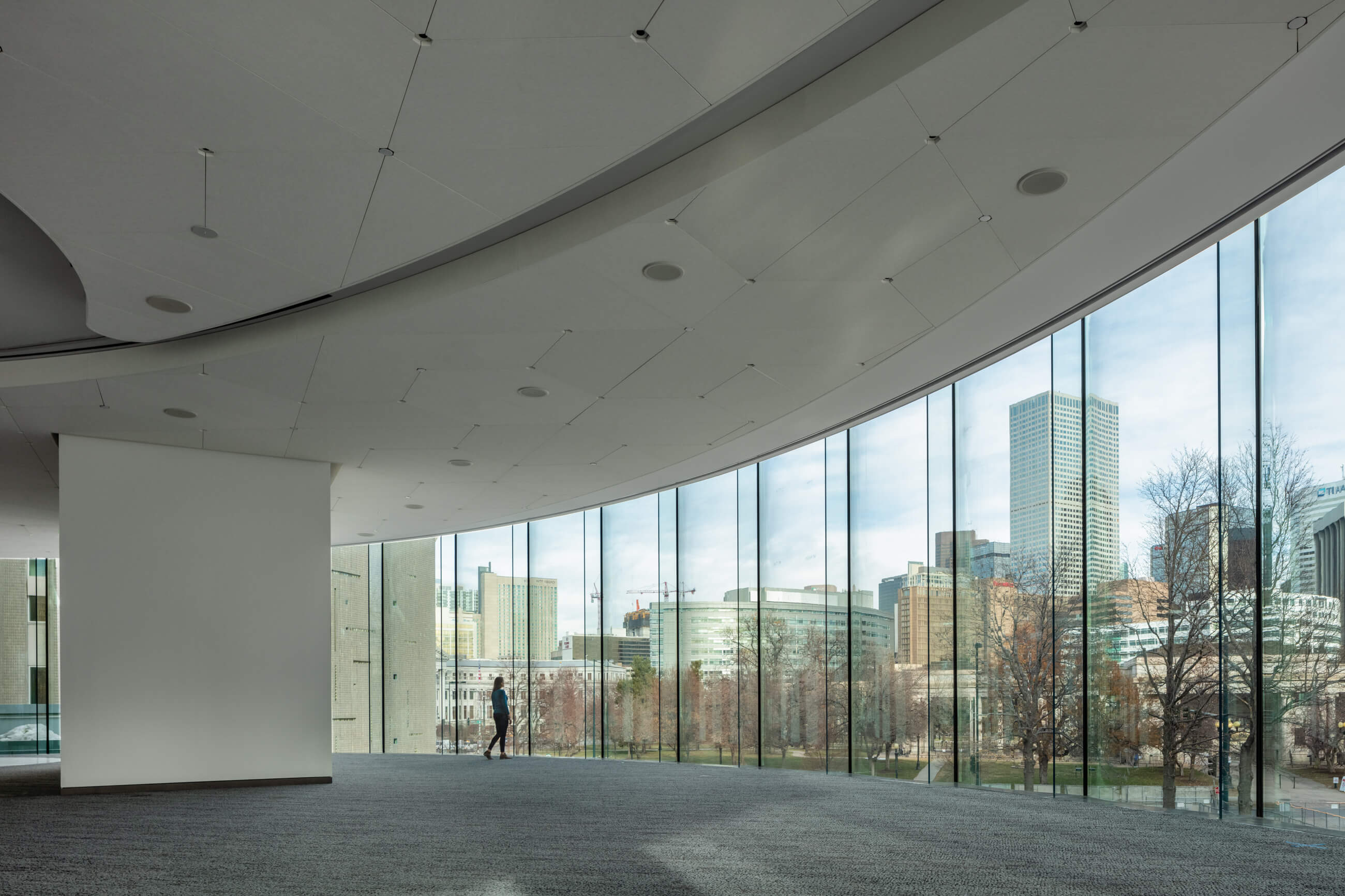 Inside of an entrance hall with curved float glass paneling