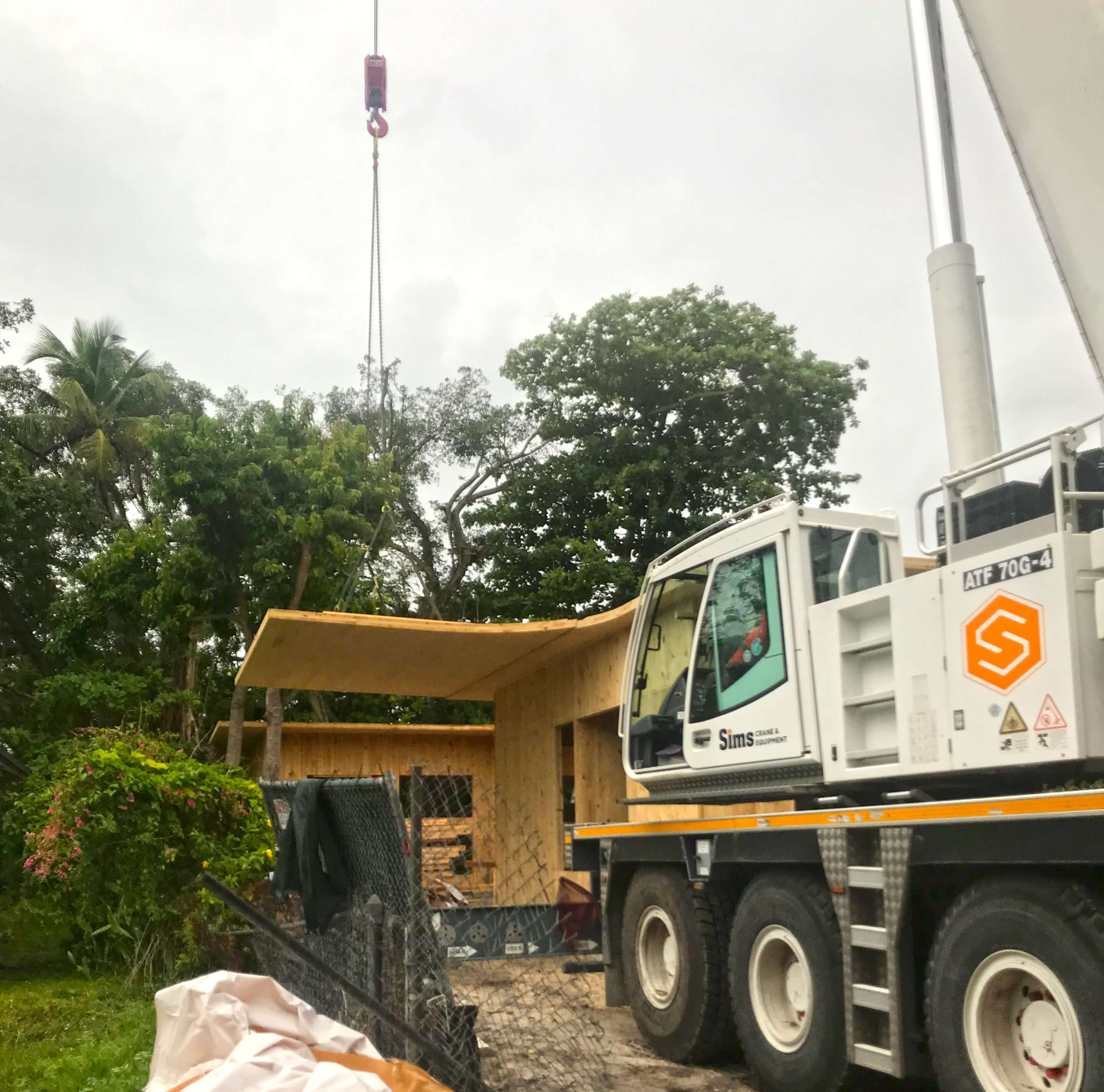 Florida timber being craned into place on a construction site